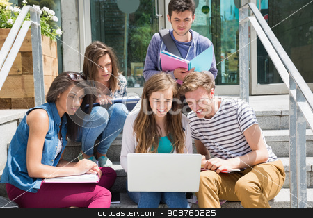 Students sitting on steps studying stock photo, Students sitting on steps studying at the university by Wavebreak Media