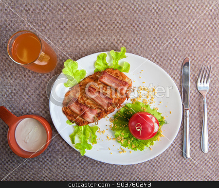 veal meat with bacon stock photo, roast of veal meat with bacon with potatoes by olinchuk