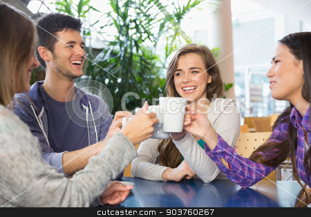 Young students having coffee together stock photo, Young students having coffee together at the university by Wavebreak Media