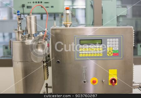 Machine used in medicine making stock photo, Machine used in medicine making at the laboratory by Wavebreak Media