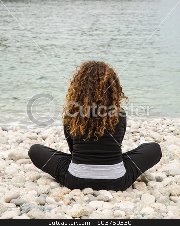 Young woman, finds herself alone, taking advantage of the holida stock photo, Mature Woman on vacation, go to the beach to find herself, with meditation, relaxation, solitude. by GCammarata
