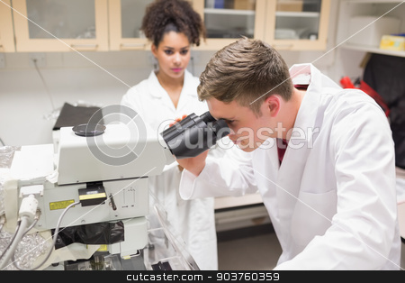 Young scientist working with microscope stock photo, Young scientist working with microscope at the university by Wavebreak Media