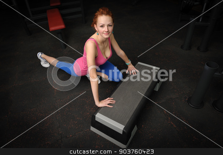 young girl do stretching stock photo, young red haired girl doing stretching in gym by Serghei Starus