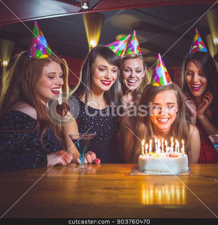 Friends celebrating a birthday together stock photo, Friends celebrating a birthday together at the nightclub by Wavebreak Media