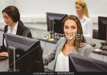 Smiling businesswoman working in computer room stock photo, Smiling businesswoman working in computer room in the office by Wavebreak Media