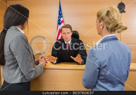 Lawyers speaking with the judge stock photo, Lawyers speaking with the judge in the court room by Wavebreak Media