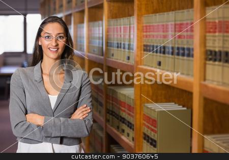 Pretty lawyer in the law library stock photo, Pretty lawyer in the law library at the university by Wavebreak Media