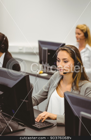 Call centre agents talking on the headset stock photo, Call centre agents talking on the headset in the office by Wavebreak Media