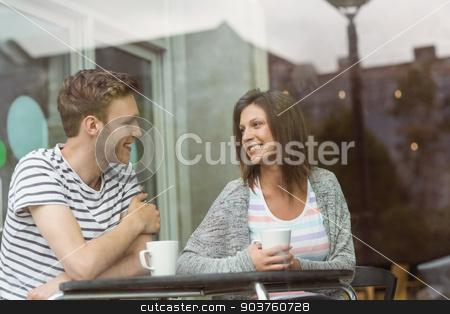 Smiling friends with mug of coffee stock photo, Smiling friends with mug of coffee in cafe at the university by Wavebreak Media