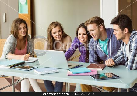 Smiling friends students using laptop stock photo, Smiling friends students using laptop at school  by Wavebreak Media