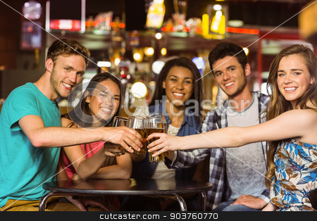 Portrait of happy friends toasting with drink and beer stock photo, Portrait of happy friends toasting with drink and beer in a pub by Wavebreak Media