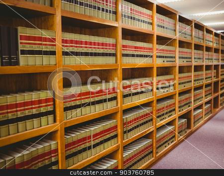 Close up of a bookshelf stock photo, Close up of a bookshelf in library by Wavebreak Media