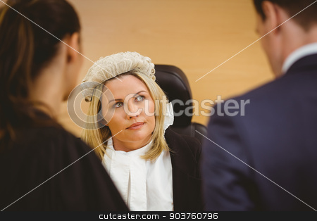 Judge and lawyer listening the criminal in handcuffs stock photo, Judge and lawyer listening the criminal in handcuffs in the court room by Wavebreak Media