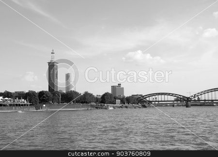 Architecture of Cologne seen from the Rhine river stock photo, The Messeturm (Fair Tower), Triangle Tower and Hohenzollernbruecke (Hohenzollern Bridge) seen from the Rhine in Cologne, Germany - monochrome processing by Sarah Marchant