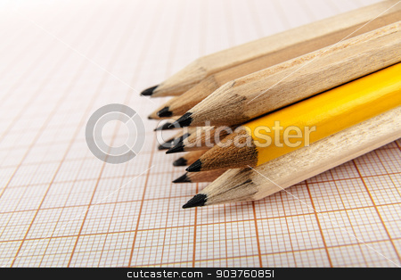 A few wooden pencils  stock photo, A few wooden pencils on graph paper background by marekusz