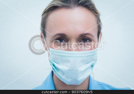 Female dentist wearing surgical mask stock photo, Portrait of female dentist wearing surgical mask by Wavebreak Media