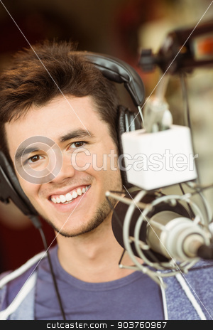 Portrait of an university student recording audio stock photo, Portrait of an university student recording audio in a studio of a radio by Wavebreak Media