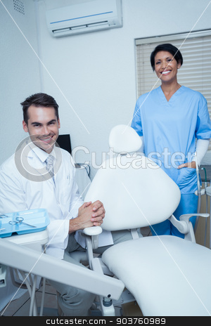 Portrait of smiling dentists stock photo, Portrait of smiling male and female dentists by Wavebreak Media