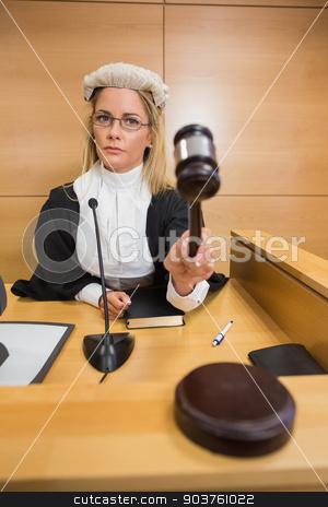 Stern judge banging her hammer stock photo, Stern judge banging her hammer in the court room by Wavebreak Media