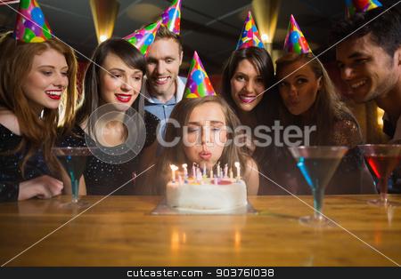 Friends celebrating a birthday together stock photo, Friends celebrating a birthday together in a bar by Wavebreak Media