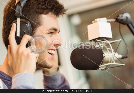 Portrait of an university student recording audio stock photo, Portrait of an university student recording audio in a studio of a radio by Wavebreak Media