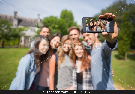Happy students taking a selfie outside on campus stock photo, Happy students taking a selfie outside on campus at the university by Wavebreak Media