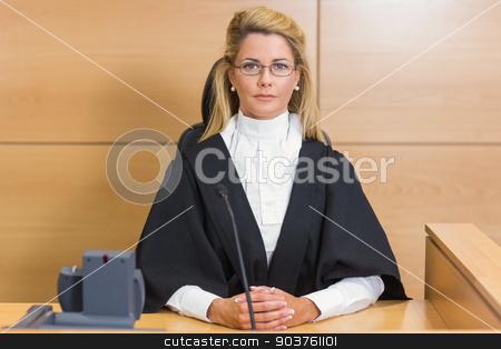 Stern judge looking at camera stock photo, Stern judge looking at camera in the court room by Wavebreak Media