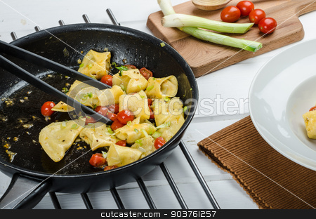 Homemade tortellini stock photo, Homemade tortellini from semolina flour, stuffed with Parmesan cheese and tomatoes by Peteer
