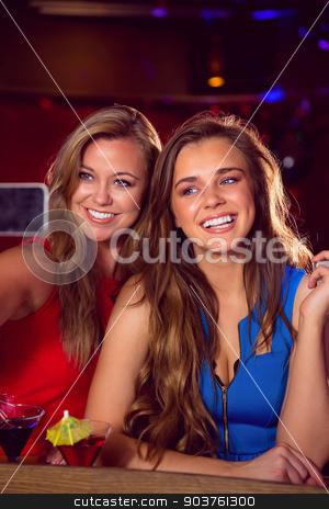 Pretty friends taking a selfie stock photo, Pretty friends taking a selfie at the nightclub  by Wavebreak Media