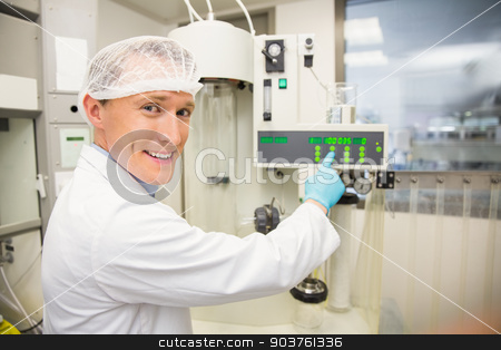Pharmacist using machinery to make medicine stock photo, Pharmacist using machinery to make medicine at the laboratory by Wavebreak Media