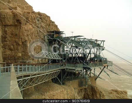 Cable car entering it's station In Masada, Israel stock photo, cable car's station in the tourist attraction King Herod's palace in Masada, Israel by Saphire Ovadia