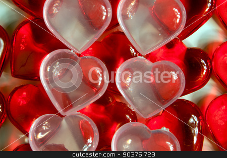 Hearts stock photo, Rows of red plastic hearts with clear hearts on top. by Scott Sanders