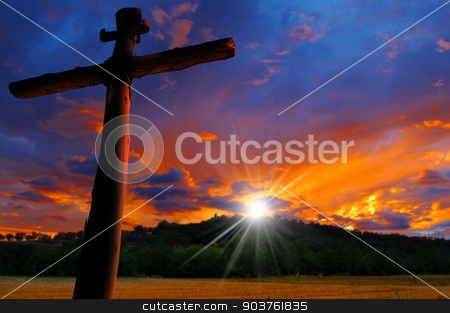 Cross Silhouette at the Sunset stock photo, Cross silhouette at the beautiful sunset over the hill with cloudy sky by catalby