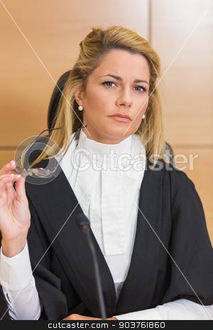 Stern judge looking away  stock photo, Stern judge looking away in the court room by Wavebreak Media