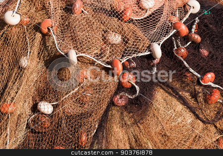 Fishing Net with Ropes and Floats stock photo, Close up of fishing net with ropes and floats in the harbor by catalby