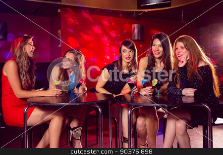 Pretty friends drinking cocktails together stock photo, Pretty friends drinking cocktails together at the nightclub  by Wavebreak Media