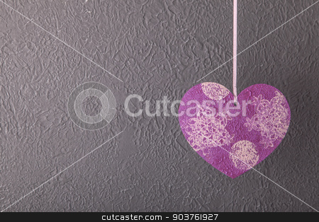 Valentines Day background with hearts stock photo, Valentines Day background with hearts against textured grey wall by Oleksandr Solonenko