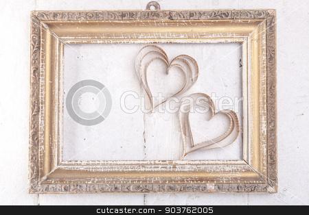 Heart-shaped cutout St Valentines hearts stock photo, Vintage book heart shaped cutout in vintage frame by Oleksandr Solonenko