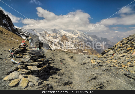 Nepal Himalayas stock photo, Prayer flags and rock piles in Himalayas mountains in Nepal by Michal Knitl