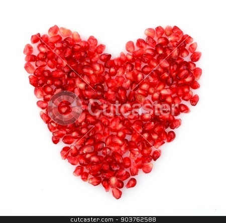 Red heart made from seeds of pomegranate,grenadine on white stock photo, Red heart made from seeds of pomegranate,grenadine on white background by Tadeusz Wejkszo