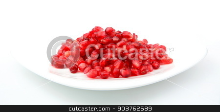 Studio shot open pomegranate on plate isolated on white stock photo, Studio shot of open pomegranate with red seeds isolated on white background by Tadeusz Wejkszo