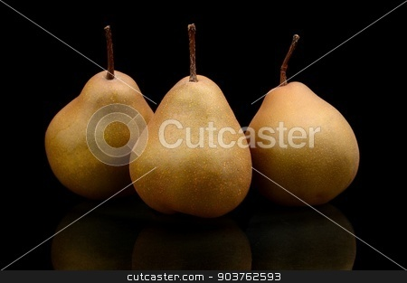 Three pears called manon isolated on black stock photo, Close-up photo of three pears called manon isolated on black background by Tadeusz Wejkszo