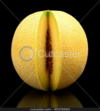 Melon galia notched isolated black in studio stock photo, Studio shot of notched ripe melon galia isolated on black background by Tadeusz Wejkszo
