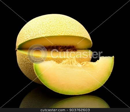 Melon galia notched with slice isolated black in studio stock photo, Studio shot of notched ripe melon galia with slice isolated on black background by Tadeusz Wejkszo