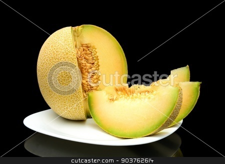 Melon galia with slices on plate isolated black in studio stock photo, Studio shot of notched ripe melon galia with slices on plate isolated on black background by Tadeusz Wejkszo
