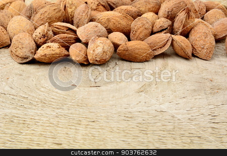 Group of almonds with shell on wooden plank,board stock photo, Group of almonds with shell on wooden plank by Tadeusz Wejkszo