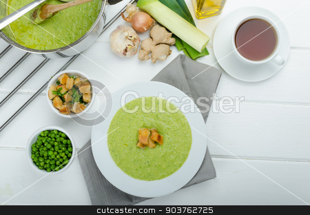 Soup of young peas stock photo, Soup of young peas, homemade crispy croutons and tea by Peteer
