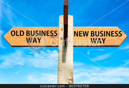 Wooden signpost with two opposite arrows over clear blue sky, Old Business Way and New Business Way, Business change conceptual image stock photo, Wooden signpost with two opposite arrows over clear blue sky, Old Business Way and New Business Way, Business change conceptual image by Constantin Stanciu