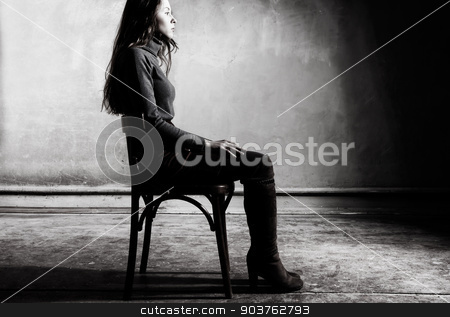 corners stock photo, young girl sitting on a chair in the gloomy place by Suchota