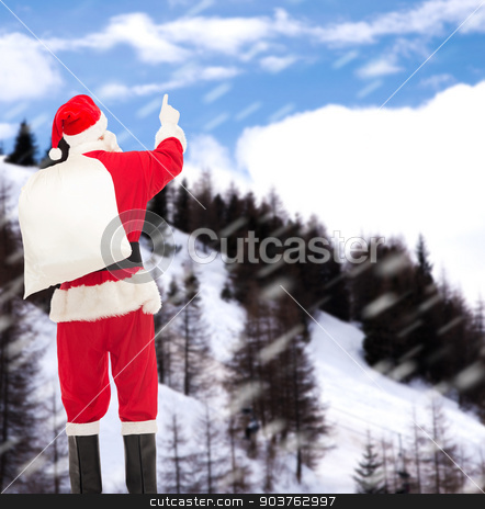 man in costume of santa claus with bag stock photo, christmas, holidays and people concept - man in costume of santa claus with bag pointing finger from back over snowy mountains background by Syda Productions